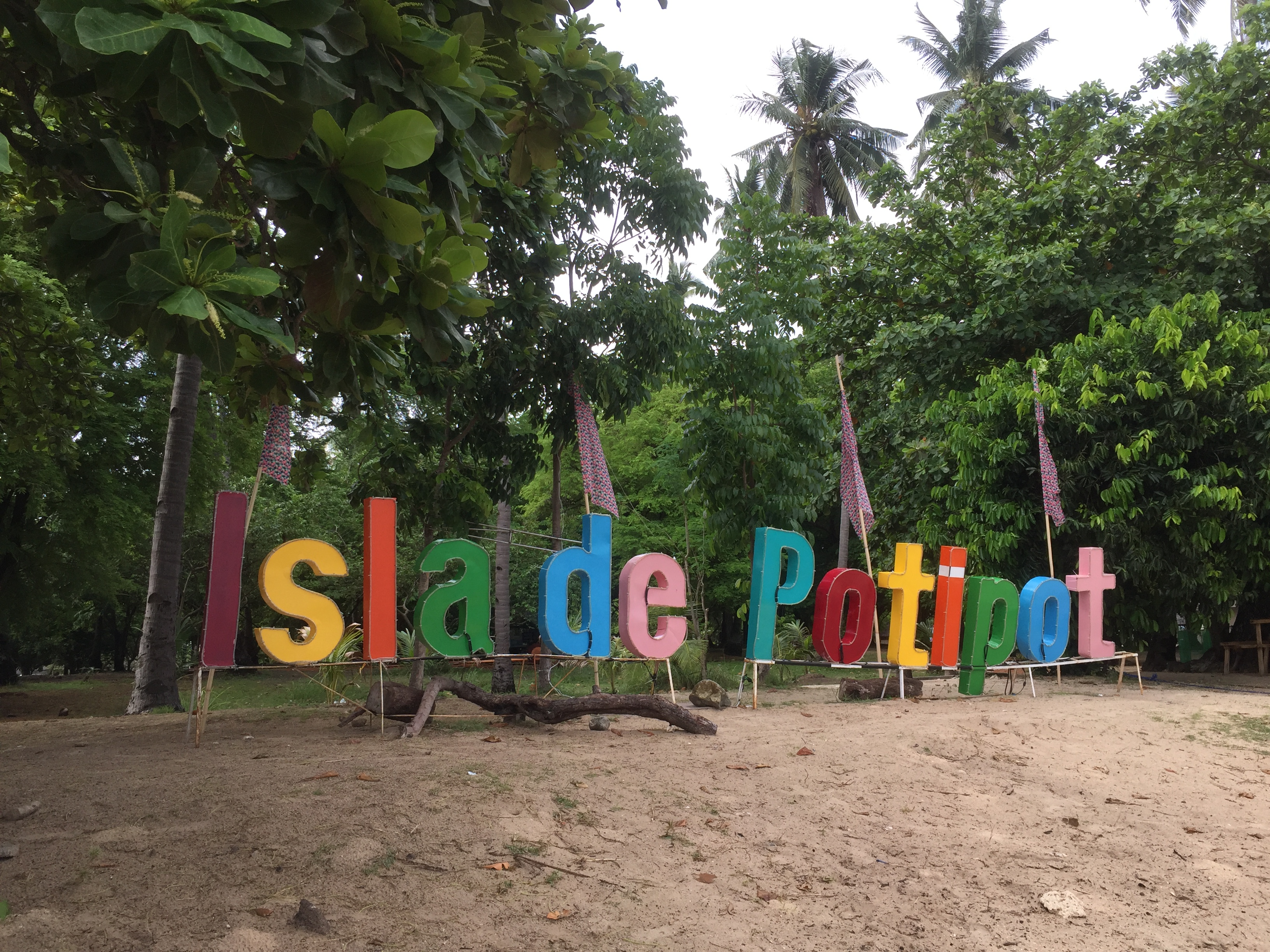 best beaches near manila welcome sign at potipot island