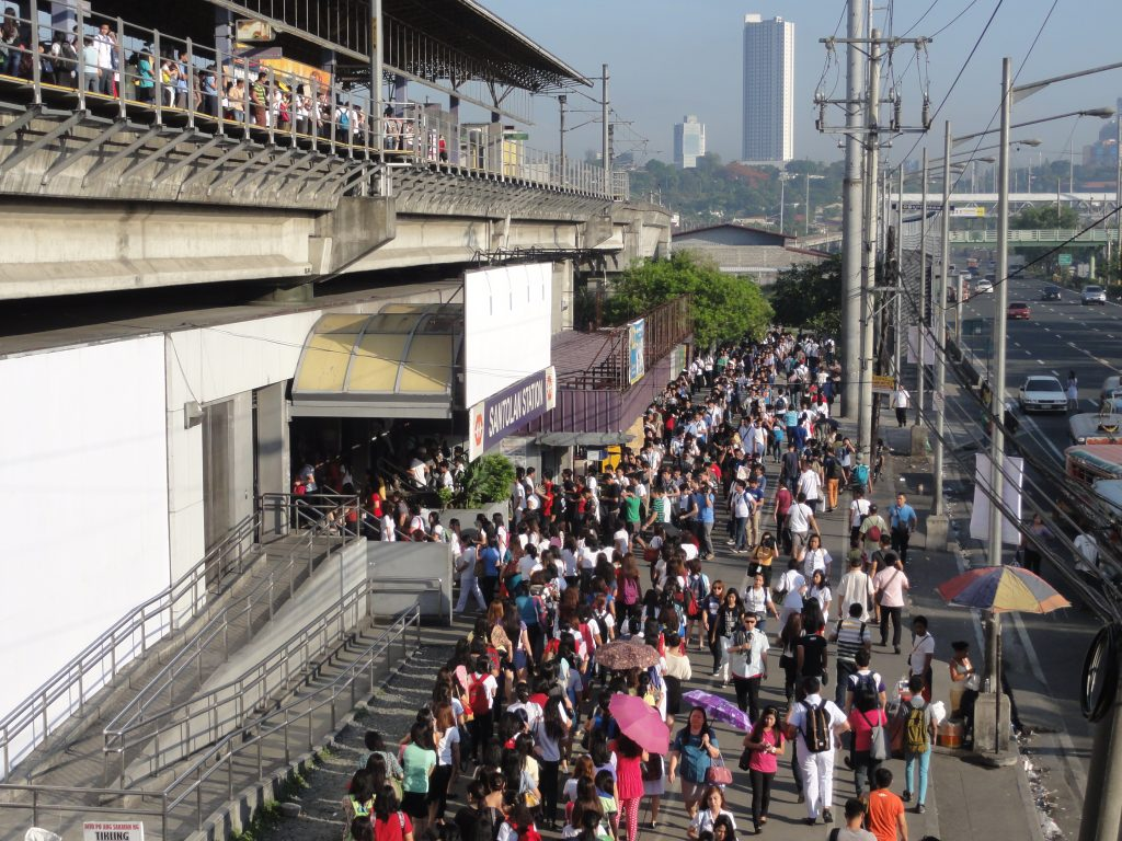 Understanding The Philippines Filipinos lining up for MRT